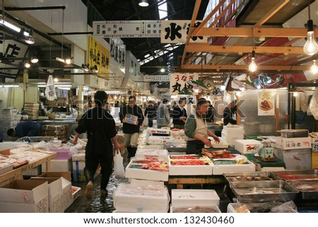 TOKYO - APRIL 13 : Fish seller at Tsukiji Market, the biggest wholesale market in Japan, market will be moved to new location in 2014, April 13, 2006 in Tokyo, Japan.