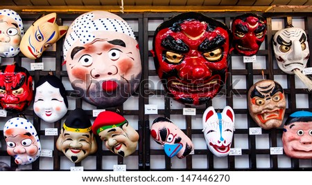 TOKYO-APRIL 7: Funny Japanese masks at the shop near Sensoji temple Tokyo, Japan on Apr 7th, 2013. Sensoji temple is the oldest Buddhist temple and the most famous tourist destination temple in Tokyo. - stock photo