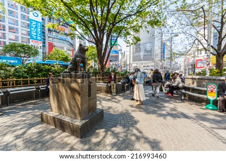 """TOKYO - APRIL 10: Hachiko Statue on April 10, 2014 in Shibuya. The station entrance near this statue is named """"The Hachiko Entrance/Exit"""", and is one of Shibuya Station's five exits. - stock photo"""