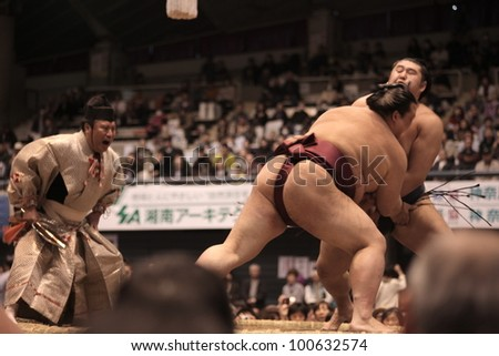 TOKYO - APRIL 7: Unidentified Sumo wrestlers in the Fujisawa tournament in Tokyo, Japan on April 7, 2012. Even though the sport is mostly dominated by foreigners it is still Japan's national sport. - stock photo
