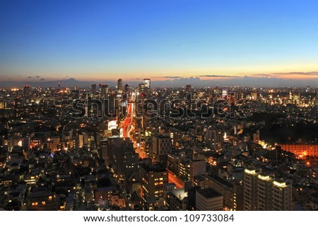 TOKYO - AUG 1: With over 35 million people, Tokyo is the world's most populous metropolis and is described as one of the three command centers for world economy August 1, 2012 in Tokyo, Japan - stock photo