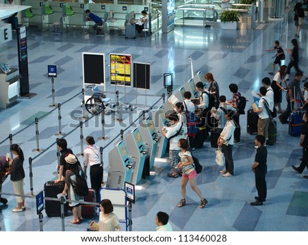 TOKYO - AUGUST 2: Check in counter at Tokyo International Airport, Tokyo on August 2, 2012. Tokyo International Airport is one of the two primary airports that serve the Greater Tokyo Area in Japan. - stock photo