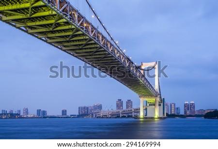Tokyo bay city and Tokyo rainbow bridge in evening - stock photo