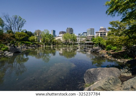 TOKYO - CIRCA APRIL 2013: pond in the park in the downtown of  Tokyo, Japan circa April 2013.