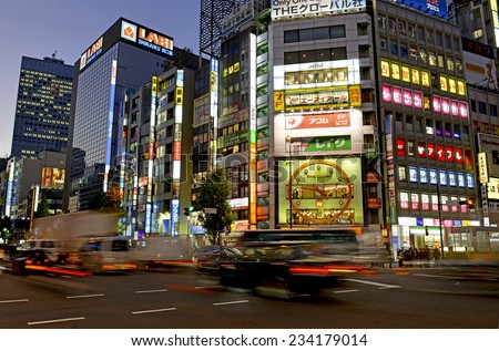 TOKYO  CIRCA NOVEMBER 2014. Despite reports of a slowing Japanese economy, the neon lights of Shinjuku reflect a vibrant hub of retail and commercial business, restaurants and entertainment. - stock photo