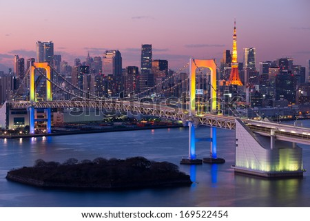 Tokyo city and rainbow bridge at twilight - stock photo