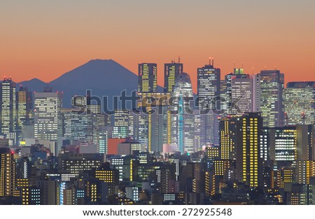 Tokyo city view and  Mountain fuji behind high building in Tokyo Shinjuku , Tokyo city is far from Mt.Fuji about 100 Km.  - stock photo