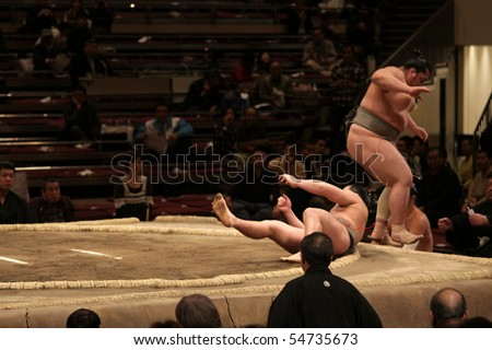 TOKYO - FEBRUARY 01: Sumo wrestler falling down after an attack during the Tokyo Grand Sumo Tournament, February 01, 2010 in Tokyo, Japan.