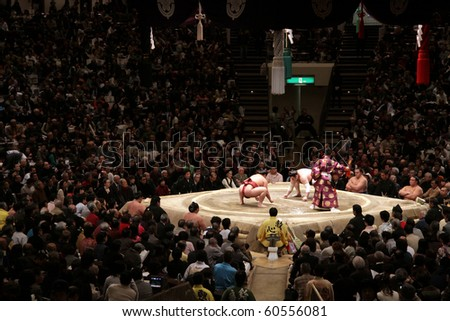 TOKYO - JANUARY 17: Judge and sumo wrestlers before a fight in the Tokyo Grand Sumo Tournament January 17, 2010 in Tokyo, Japan.