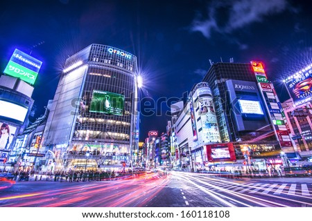 TOKYO - JANUARY 10: Shibuya Crossing January 10, 2013 in Tokyo, JP. The intersection is known as the busiest in the world. - stock photo