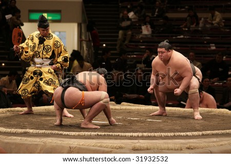 TOKYO - JANUARY 21: Sumo wrestler Chiyotaikai gathering strength in the Tokyo Grand Sumo Tournament January 21, 2009 in Tokyo, Japan. - stock photo