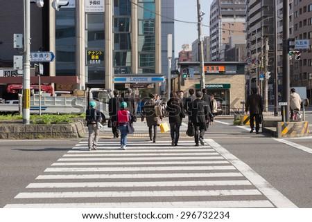 Tokyo JAPAN - Apr 11: Unidentified people walks across crosswalk on April 11,2014 at Tokyo, Japan. - stock photo