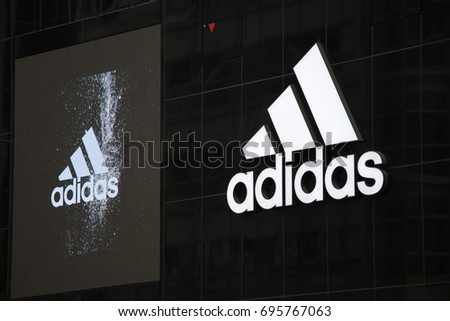TOKYO, JAPAN -  April 29, 2017:Adidas logo inretail store at Shibuya, Tokyo. Adidas is the company about  sportwear and clothing.