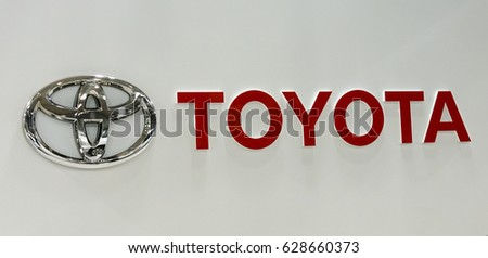 TOKYO, JAPAN  - APRIL O4, 2017 : Toyota automobile dealership sign. Toyota is a multi-national Japanese automotive manufacturer.