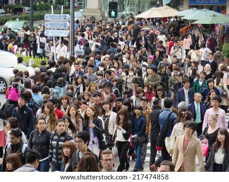 TOKYO JAPAN - APRIL 19 : Omotesando district on April 19, 2014 in Tokyo, Japan. Omotesando is very popular shopping street with crowd on holiday weekend. - stock photo