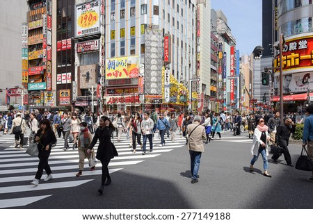 Tokyo, Japan - April 18, 2015: Pedestrians walk at Kabuki-cho district. The area is a entertainment and nightlife district known as Sleepless Town in Tokyo.