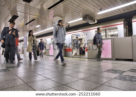 TOKYO, JAPAN - APRIL 13, 2012: People exit Tokyo Metro. With more than 3.1 billion annual passenger rides, Tokyo subway system is the busiest worldwide. - stock photo