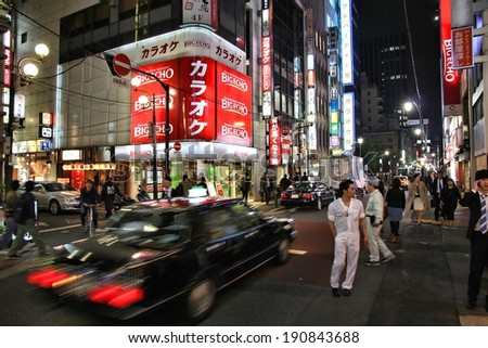 TOKYO, JAPAN - APRIL 13, 2012: People visit Yaesu neighborhood in Tokyo. Tokyo is the capital city of Japan, 35 million people live in its urban area. - stock photo
