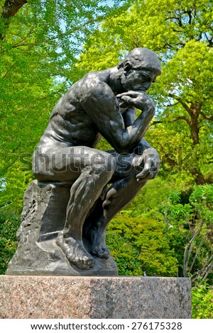 TOKYO, JAPAN - APRIl 15 : Rodin: The Thinker copy at Ueno Park on 15 April 2015 in Tokyo, Japan. There is a small outdoor art gallery in Ueno Park with Rodin statues. - stock photo