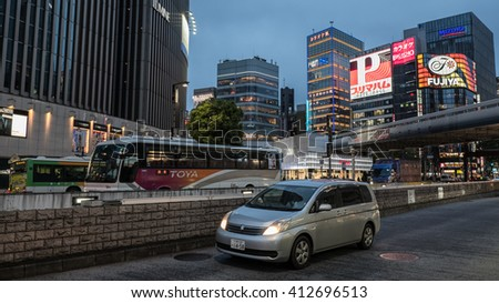 TOKYO, JAPAN - APRIL 28TH, 2016: Modern buildings in Ginza districts at night.