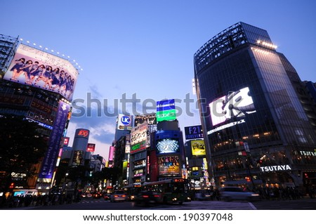 Tokyo, Japan - April 24, 2014 : Tourists and business people crossing the street at Shibuya intersection  - stock photo