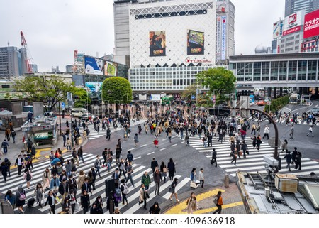 TOKYO, JAPAN - April 14, 2016 - Unidentified pedestrians at Shibuya Crossings in Tokyo. One of the busiest crosswalks in the world - stock photo