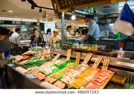 Tokyo, Japan - Aug 9, 2016 -  An unidentified man sells assorted both fresh seafood product at Tsukiji fish market