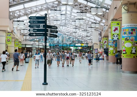 TOKYO JAPAN - Aug 9, 2015: Unidentified people travel at Ueno train station. Ueno is best known as the home of Ueno Park and the Tokyo National museum. - stock photo