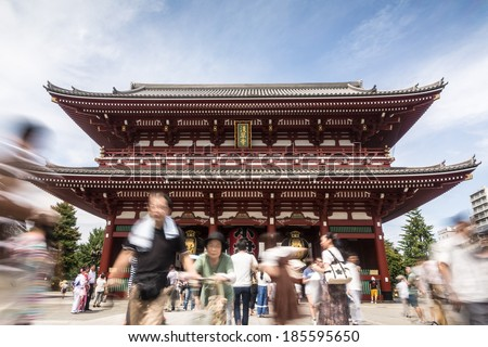Tokyo, Japan - August 24 2013: A Blurred crowd walks in front the Senso-ji, a famous Buddhist temple in Tokyo historic area (Asakusa) - stock photo
