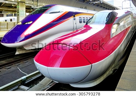 TOKYO, JAPAN -8 AUGUST 2015- A red E6 Series Shinkansen high-speed bullet train operated by JR East at the Tokyo station. - stock photo