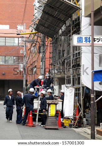 TOKYO, JAPAN- AUGUST 22, 2013: Foreman and builder are maintain building in Tokyo, Japan. August 22 2013