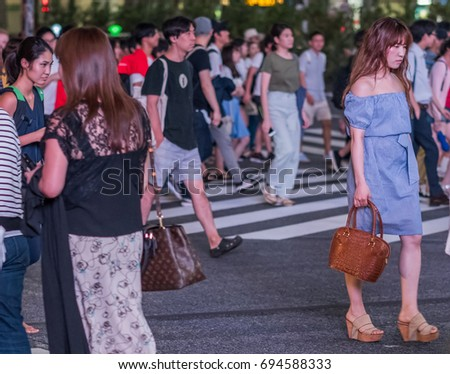 TOKYO, JAPAN - AUGUST 9TH, 2017.  Crowd of people at the famous Shibuya street scramble crossing at night.