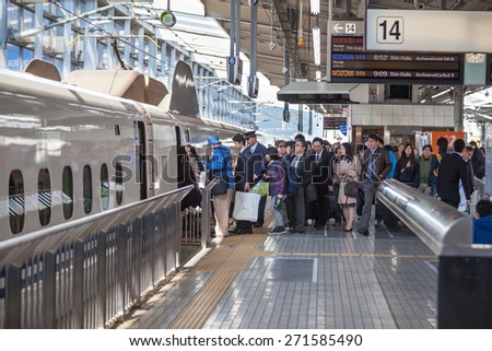 TOKYO, JAPAN - CIRCA APR, 2013: Queue for boarding the train-bullet (Shinkansen) to the Kyoto city is in the Tokyo rail station. Tokyo Station is railway station in the Marunouchi district of Chiyoda - stock photo