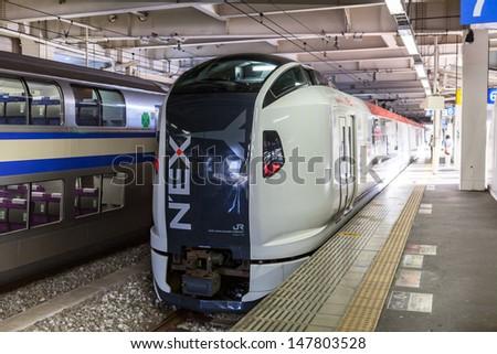 TOKYO, JAPAN - CIRCA APRIL, 2013: Narita Express (NEX) shinkansen is a bullet train from Tokyo city to airport in Narita on circa April, 2013 in Tokyo,  - stock photo