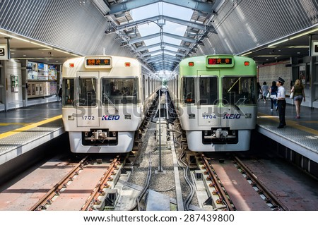 TOKYO, JAPAN - CIRCA JULY 2014: Japanese trains at a station. Train is the main method of transportation in Japan. - stock photo