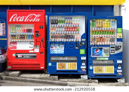 TOKYO, JAPAN - CIRCA MAY, 2014:  Vending machines of various company in Tokyo. Japan has the highest number of vending machine per capita in the world at about one to twenty three people. - stock photo
