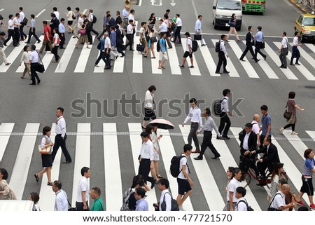 TOKYO, JAPAN, CIRCA 2016 - Pedestrians on the big street in the city center circa 2016 in Tokyo, Japan