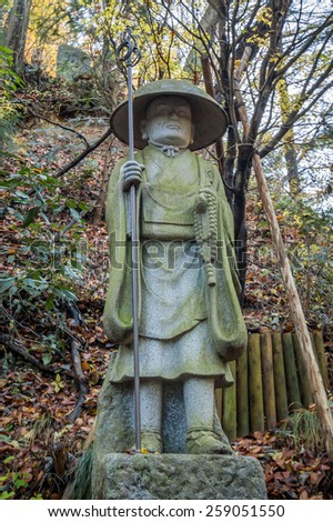 TOKYO, JAPAN - DEC 01, 2014: Buddha statues at a Buddhist temple on the Holy Mount Takao near Tokyo, Japan - stock photo