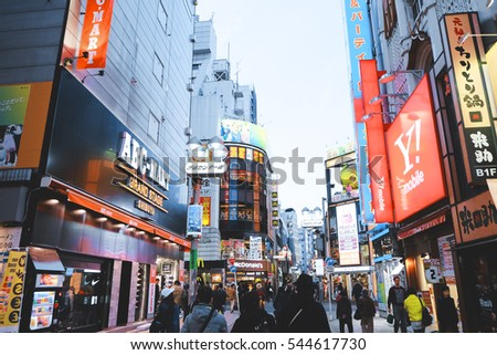 Tokyo, Japan, Dec 8, 2016: Shibuya Crossing Of City street with crowd people on zebra crosswalk in Shibuya town. Shibuya is a special ward located in Tokyo for shopping at night.
