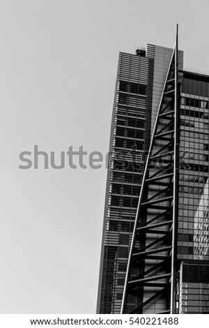 TOKYO, JAPAN. DECEMBER 9, 2015; Building facade in center business district of Japan. Black and white shot.
