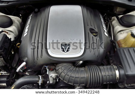 Tokyo, Japan - December 2, 2015: Engine compartment of the Dodge Magnum (2006 type). Engine body is covered in engine cover. - stock photo
