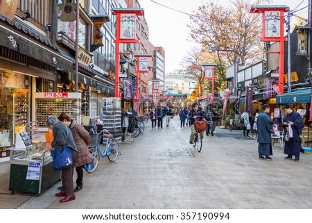 TOKYO -JAPAN December 7 2015 : Many People shopping street in Asakusa area neary Senso-ji Temple in Asakusa, Tokyo on 7 December 2015.The Senso-ji TempleAsakusa is the most famous temple in tokyo - stock photo