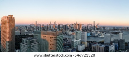 Tokyo, Japan - December 18, 2014: Panoramic view of Tokyo skyline with harbour during sunset