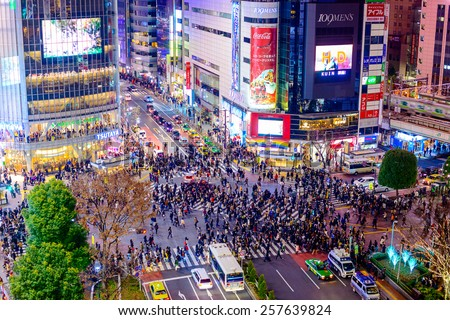 TOKYO, JAPAN - DECEMBER 23, 2012: Pedestrians cross at Shibuya Crossing. It is one of the world's most famous scramble crosswalks. - stock photo