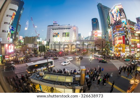 TOKYO, JAPAN - DECEMBER 19, 2014: Pedestrians walk at Shibuya Crossing during the holiday season, one of the busiest crosswalks in the world.