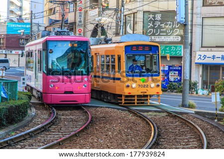 TOKYO, JAPAN DECEMBER 3: Tram in Otsuka Tokyo, Japan December 3, 2013.  Tram  provide easy access to most city's main attractions and run every 5-8 minutes - stock photo