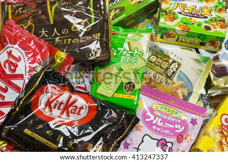 TOKYO, JAPAN - FEBRUARY 16, 2013: Japanese Sweets Snack in Narita airport duty free shop green tea matcha, sakura-matcha, and chocolate Kit Kat, Hello Kitty, Lotte is most popular for tourist