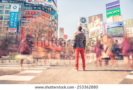 TOKYO,JAPAN - FEBRUARY 11,2015: Man standing in Shibuya square. The scramble crosswalk is one of the largest in the world. - stock photo