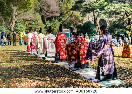TOKYO, JAPAN - JAN 4: Traditional Japanese archers pictured on January 4th, 2016, in Tokyo, Japan. Traditional archery is one of the most popular tourist attraction in Meiji park in Tokyo. - stock photo