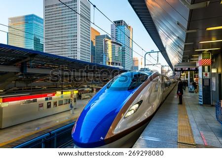 TOKYO, JAPAN - JANUARY 3: A Shinkansen train pulls into Tokyo Station on January 3, 2015 in Tokyo, Japan. - stock photo